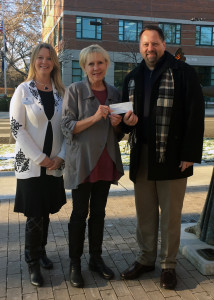 WCA's Diana Burrell and Bev La Chance accept a check from Nagel Foundation's Curt Goldgrabe.