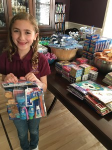 """For her Faith in Action Project, Lexie provided 50 """"Blessing Bags"""" for our clients filled with toiletries, snacks and fun activities."""